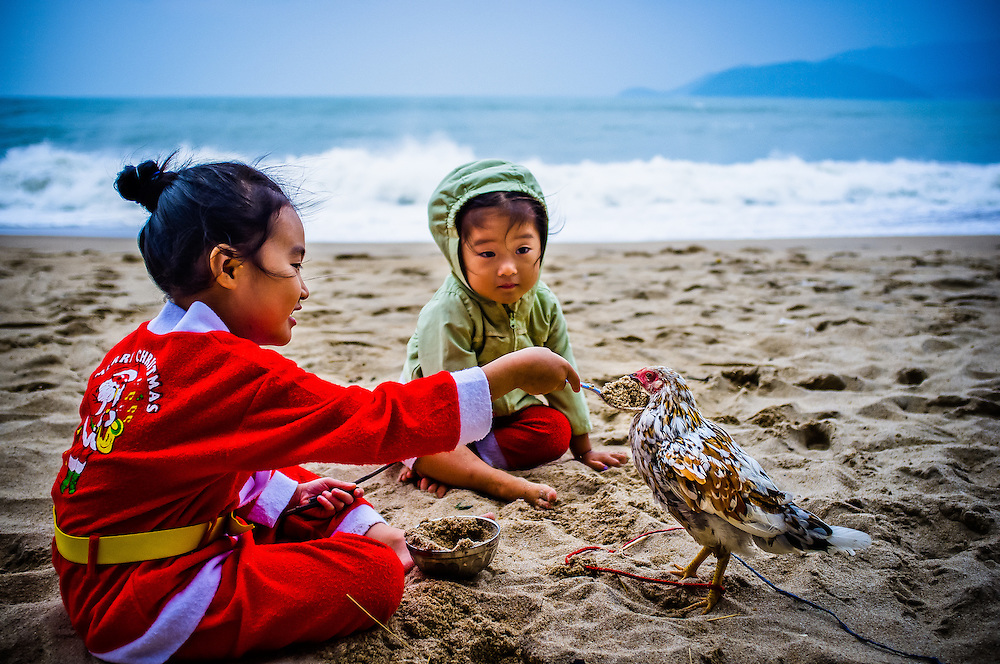 Young girls play on the beach in Nha Trang, Vietnam on Christmas Day 2011.
