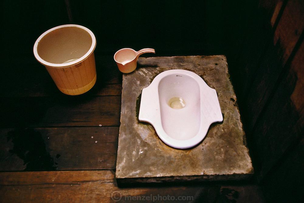 Sawa Village Mission squat toilet, Irian Jaya, Indonesia.