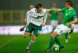 Josip Ilicic of Slovenia vs Gareth McAuley of Northern Ireland during EURO 2012 Quaifications game between National teams of Slovenia and Northern Ireland, on March 29, 2011, in Windsor Park Stadium, Belfast, Northern Ireland, United Kingdom. (Photo by Vid Ponikvar / Sportida)