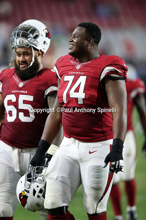 Arizona Cardinals rookie offensive tackle D.J. Humphries (74) smiles as he walks off the field after the 2015 NFL preseason football game against the San Diego Chargers on Saturday, Aug. 22, 2015 in Glendale, Ariz. The Chargers won the game 22-19. (©Paul Anthony Spinelli)