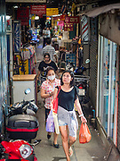 11 OCTOBER 2015 - BANGKOK, THAILAND:  Shoppers in the Saphan Han market get in the last day of shopping before the market is closed by Bangkok city officials. Many shops in the market are already closed. Street vendors and illegal market vendors in the Saphan Han and Saphan Lek markets will be removed in the next two weeks as a part of an urban renewal project coordinated by the Bangkok Metropolitan Administration. About 500 vendors along Damrongsathit Bridge, popularly known as Saphan Lek, have until Monday, October 11,  to relocate. Vendors who don't move will be evicted. Saphan Lek is one of several markets and street vending areas being closed in Bangkok this year. The market is known for toy and replica guns, bootleg and pirated DVDs and CDs and electronic toys.   PHOTO BY JACK KURTZ