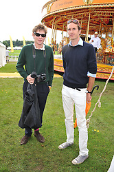 Left to right, NIKOLAI VON BISMARCK and OTIS FERRY at the 2012 Veuve Clicquot Gold Cup Final at Cowdray Park, Midhurst, West Sussex on 15th July 2012.