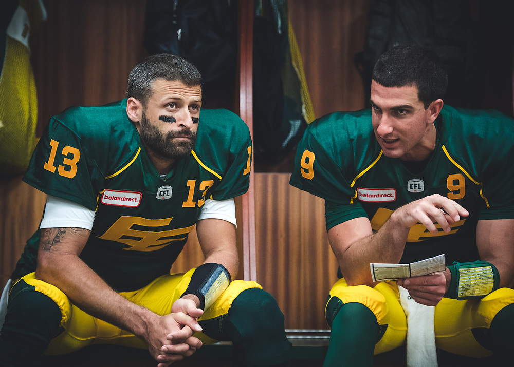 Mike Reilly (13) and Danny O'Brien (9) of the Edmonton Eskimos in the locker room before the game against the Calgary Stampeders at Commonwealth Stadium in Edmonton AB, Saturday, September 9, 2017. (Photo: Johany Jutras)