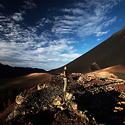 Woman walking at the base of Pico Fogo, Fogo Island, Cape Verde, West Africa.