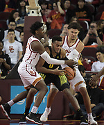 Feb 15, 2018; Los Angeles, CA, USA;  Oregon Ducks forward Troy Brown (0) battles for the ball with Southern California Trojans guard Jonah Mathews (2) and guard Jordan Usher (1) during an NCAA basketball game at Galen Center. USC defeated Oregon 72-70.