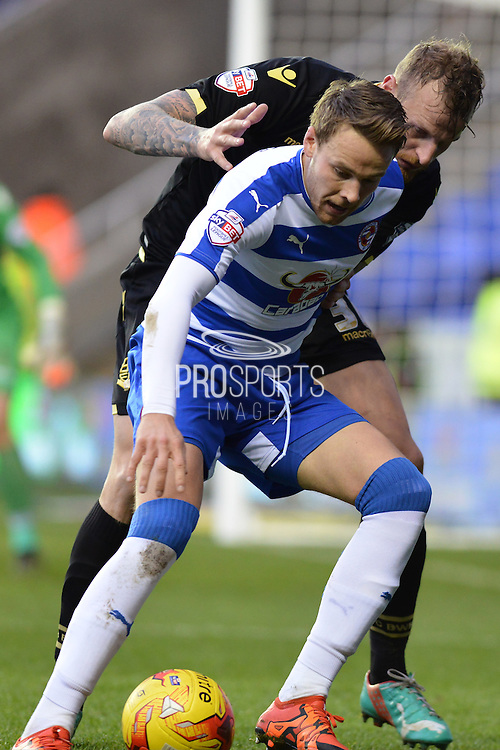 Reading's Chris Gunter holds off Bolton Wanderers defender David Wheater during the Sky Bet Championship match between Reading and Bolton Wanderers at the Madejski Stadium, Reading, England on 21 November 2015. Photo by Mark Davies.