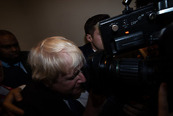 © Licensed to London News Pictures . 02/10/2018. Birmingham, UK. BORIS JOHNSON pushes through a media scrum ahead of his speech at the conference on day 3 of the Conservative Party conference at the ICC in Birmingham . Photo credit: Joel Goodman/LNP