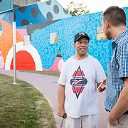 "Former Hagerstown Mayor, David Gysberts, right, speaks with Herman ""Skip"" Davis near a gigantic mural painted on the side of a former grain mill in downtown Hagerstown, Maryland, on Tuesday, September 26, 2017. The mural was the last contract that Gysberts signed before leaving office last year. Originally a District that was mostly rural, but included towns like Frederick and Hagerstown, Maryland's 6th District was redistricted in 2011, combining rural northern Maryland regions with more affluent communities like near Washington D.C. turning the district from Republican to Democrat. <br />  <br /> CREDIT: John Boal for The Wall Street Journal<br /> GERRYMANDER"