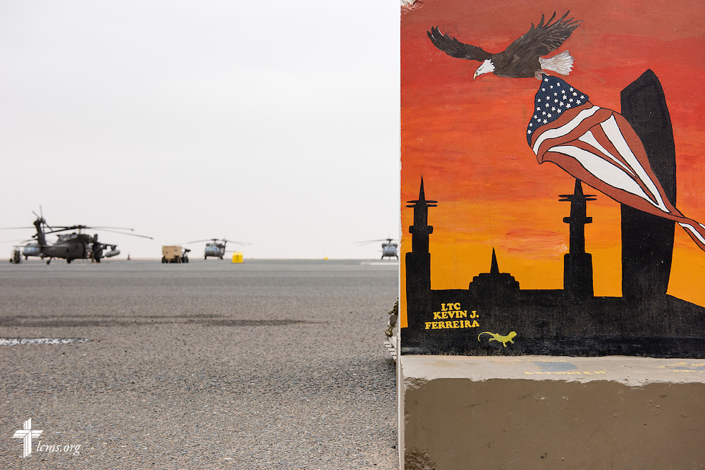 A painted mural gives way to the helicopter flight line on Sunday, March 22, 2015, at Camp Buehring in Kuwait. LCMS Communications/Erik M. Lunsford