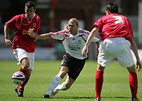 Photo: Paul Thomas.<br />Crewe Alexandra v Liverpool. Pre Season Friendly. 14/07/2007.<br /><br />Andriy Voronin (C) of Liverpool battles with Steven Schumacher (L).