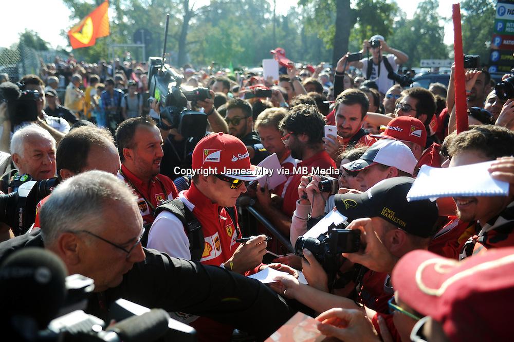 Kimi Raikkonen (FIN) Ferrari signs autographs for the fans.<br /> Italian Grand Prix, Saturday 6th September 2014. Monza Italy.