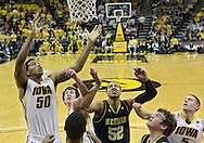 February 19 2011: Iowa Hawkeyes forward Jarryd Cole (50), Iowa Hawkeyes forward Zach McCabe (15), Michigan Wolverines forward Jordan Morgan (52), Michigan Wolverines guard/forward Zack Novak (0), and Iowa Hawkeyes guard Matt Gatens (5) battle for a rebound during the first half of an NCAA college basketball game at Carver-Hawkeye Arena in Iowa City, Iowa on February 19, 2011. Michigan defeated Iowa 75-72 in overtime.