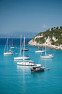 Sailing yachts in Lakka harbour on the island of Paxos, The Ionian Islands, The Greek Islands, Greece, Europe
