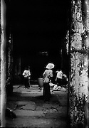 Khmer family making offerings at a shrine in a temple at Angkor.
