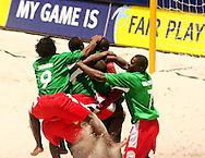 Football - FIFA Beach Soccer World Cup 2006 - Group C - CMR X URU  - Rio de Janeiro - Brazil 06/11/2006<br />Cameroon team celebrates their victory - Event Title Board Mandatory Credit: FIFA / Ricardo Moraes
