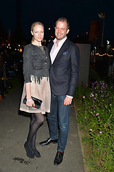 JADE PARFITT and JACK DYSON at the Battersea Power Station Annual Party at Battersea Power Station, 188 Kirtling Street, London SW8 on 30th April 2014.