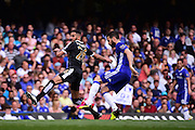 Chelsea Midfielder Cesc Fabregas (4) in action with Leicester City Midfielder Riyad Mahrez (26) during the Barclays Premier League match between Chelsea and Leicester City at Stamford Bridge, London, England on 15 May 2016. Photo by Jon Bromley.
