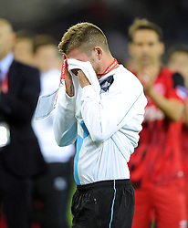 Sevilla's Alberto Moreno is in tears as he says good-bye to the Sevilla fans and team mates ahead of his 12 million pound move to Liverpool - Photo mandatory by-line: Joe Meredith/JMP - Mobile: 07966 386802 12/08/2014 - SPORT - FOOTBALL - Cardiff - Cardiff City Stadium - Real Madrid v Sevilla - UEFA Super Cup
