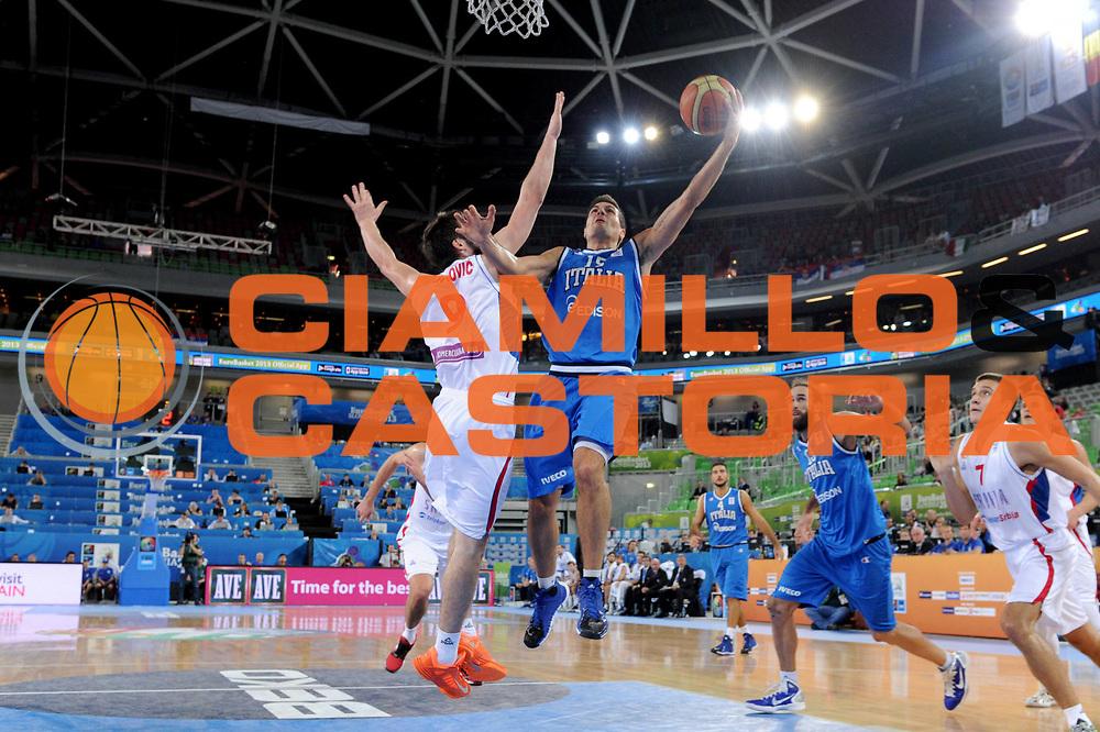 DESCRIZIONE : Lubiana Ljubliana Slovenia Eurobasket Men 2013 Finale Settimo Ottavo Posto Serbia Italia Final for 7th to 8th place Serbia Italy<br /> GIOCATORE : Andrea Cinciarini<br /> CATEGORIA : tiro shot<br /> SQUADRA : Italia Italy<br /> EVENTO : Eurobasket Men 2013<br /> GARA : Serbia Italia Serbia Italy<br /> DATA : 21/09/2013 <br /> SPORT : Pallacanestro <br /> AUTORE : Agenzia Ciamillo-Castoria/C.De Massis<br /> Galleria : Eurobasket Men 2013<br /> Fotonotizia : Lubiana Ljubliana Slovenia Eurobasket Men 2013 Finale Settimo Ottavo Posto Serbia Italia Final for 7th to 8th place Serbia Italy<br /> Predefinita :