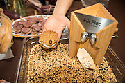 Sarah Minnick, of Lovely's Fifty-Fifty, created ice cream sandwiches with triple barley 'Interlaken' raisin cookies and malted-roasted barley ice cream. with the Boutards mixed hulless barley. The Flic Floc machine grinds the barley.