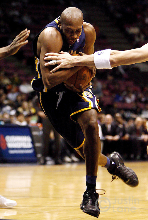 epa00615049 The Pacers' Anthony Johnson drives to the basket during the Indiana Pacers' 97-92 loss to the New Jersey Nets at Continental Airlines Arena Monday 16 January 2006 in East Rutherford, New Jersey.  EPA/JUSTIN LANE