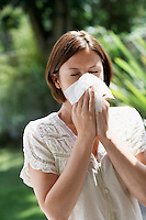 Woman Blowing Nose in garden