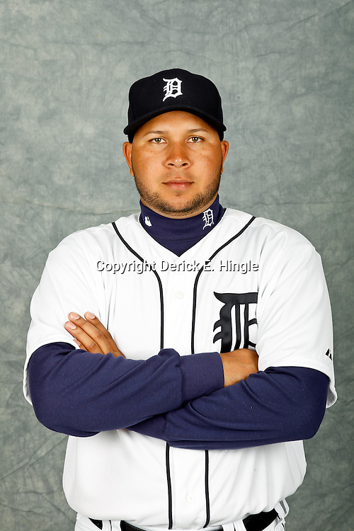 February 28, 2012; Lakeland, FL, USA; Detroit Tigers shortstop Jhonny Peralta (27) poses for photo day in the rec room at the Detroit Tigers Headquarters.  Mandatory Credit: Derick E. Hingle-US PRESSWIRE