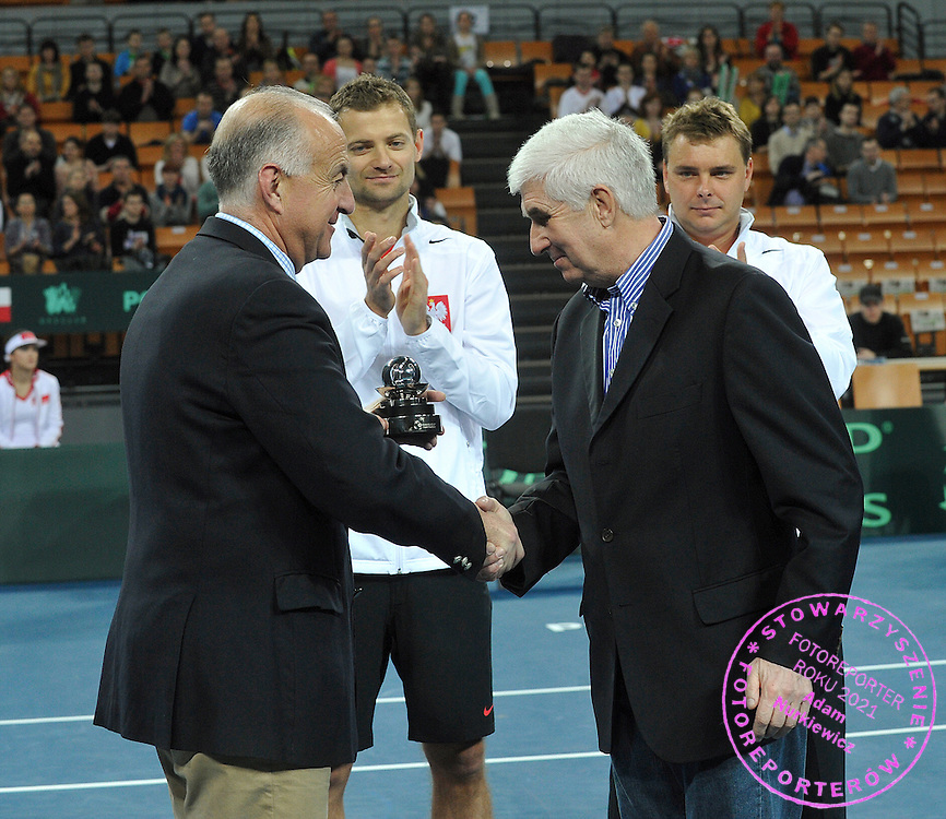 BNP Paribas Davis Cup 2013.BNP Paribas Davis Cup 2013 between Poland and Slovenia at Hala Stulecia in Wroclaw on Ferbruary 2nd , 2013..Davis Cup Commitment Award presentations.ITF Referee Javier Sansierra and Tadeusz Nowicki .Photo by: Piotr Hawalej