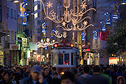 Istanbul. Tramway in Istiklal Street pedestrian zone at dusk.