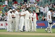 Andrew Strauss leaves the field as The Protea's celebrate during day 3 of the 4th Castle Test between South Africa and England held at The Bidvest Wanderers Stadium in Johannesburg, South Africa on the 16 January 2010.Photo by:  Ron Gaunt/SPORTZPICS