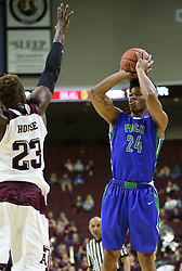 Florida Gulf Coast University's Rayjon Tucker (24) attempts a three point shot over Texas A&M's Danuel House (23) during a NCAA college basketball game in College Station, Texas, Wednesday, Dec. 2, 2015.  (AP Photo/Sam Craft)