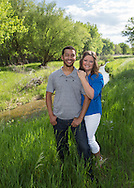 Engagement picture of couple by a stream, Longmont