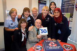 Natwest Bank Gleadless branch 50th Birthday 15th October 2010 .Banks oldest customer 96 year old Douglas Higgins with NatWest Staff from left to right Pam Bartrop, Kathy Throssell, Laura Nicholson, Jill Smith, Alison Hobson, Louise Ironmonger and Sakira Baris.Images © Paul David Drabble