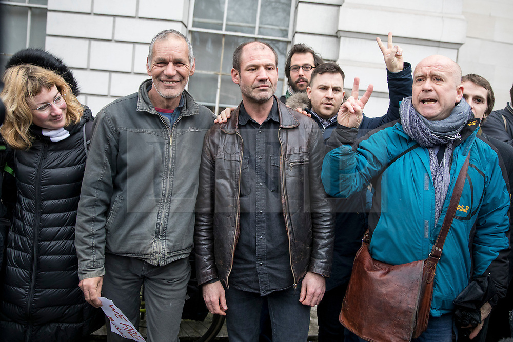 © Licensed to London News Pictures. 14/02/2018. London, UK. James (Jim) Matthews (third left) poses with well-wishers as he arrives at Westminster Magistrates Court to appear charged with one count of 'attending a place used for terrorist training', under section 8 of the Terrorism Act 2006. The former British Army soldier fought with Kurdish forces - the YPG - against ISIS in Syria. Photo credit : Tom Nicholson/LNP