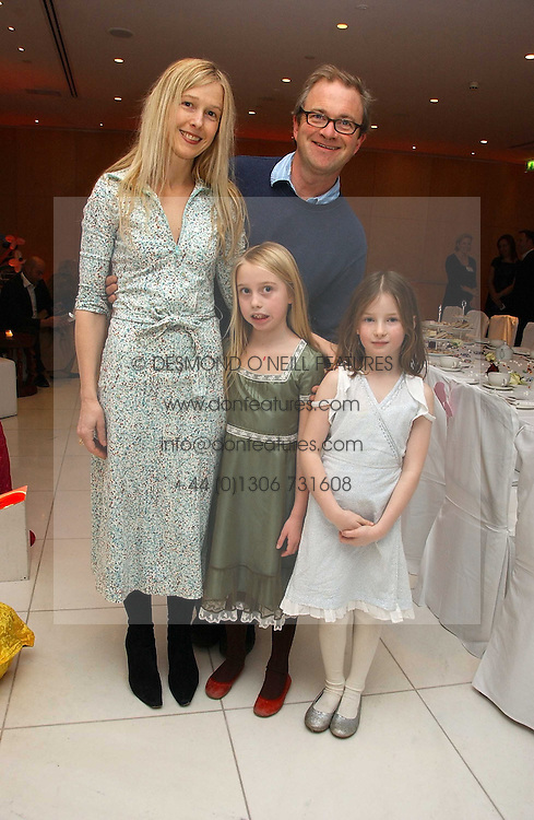 Comedian HARRY ENFIELD, his wife LUCY and children (left to right) POPPY and MARNIat the English National Ballet's Mad Hatters Tea Party at St.Martins Lane Hotel, St Martins Lane, London on 12th December 2006.<br />