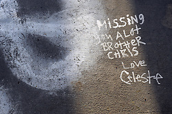 "Written on the sidewalk by his sister Celeste in 2011, a note to Chris Lopez, then 22 years-old, is still poignant. Families on Sunday held a ""100 Mothers"" vigil in north Salinas for victims of Monterey County violence."