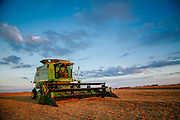 John Deer combine in Iowa.<br /> Photographed by commercial lifestyle Texas photographer Nathan Lindstrom