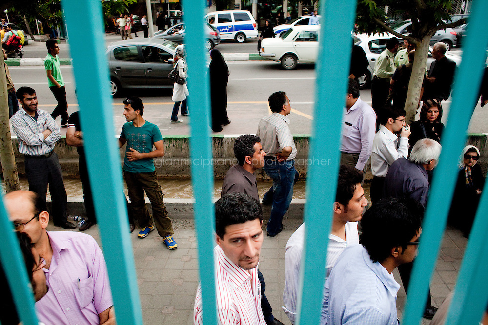 12 June, 2009. Tehran, Iran. Voters wait in line to cast their vote at the Hosseinie Ershad Mosque in Tehran. Conservative reformist candidate Mir Hossein Mousavi is running against the ultra-conservative current President of Iran Mahmoud Ahmadinejad.<br /> &copy;2009 Gianni Cipriano<br /> cell. +1 646 465 2168 (USA)<br /> cell. +39 328 567 7923<br /> gianni@giannicipriano.com<br /> www.giannicipriano.com