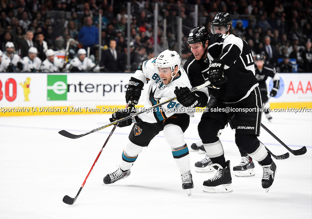 27 December 2014: San Jose Sharks Left Wing Barclay Goodrow (89) [9171] looks for an open shot on goal against Los Angeles Kings Defenseman Matt Greene (2) [2970] during an NHL game between the San Jose Sharks and the Los Angeles Kings at STAPLES Center in Los Angeles, CA.
