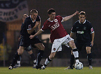 Photo: Olly Greenwood.<br />Southend United v Manchester United. Carling Cup. 07/11/2006. Manchester United's David Jones and Southend's Peter Clarke