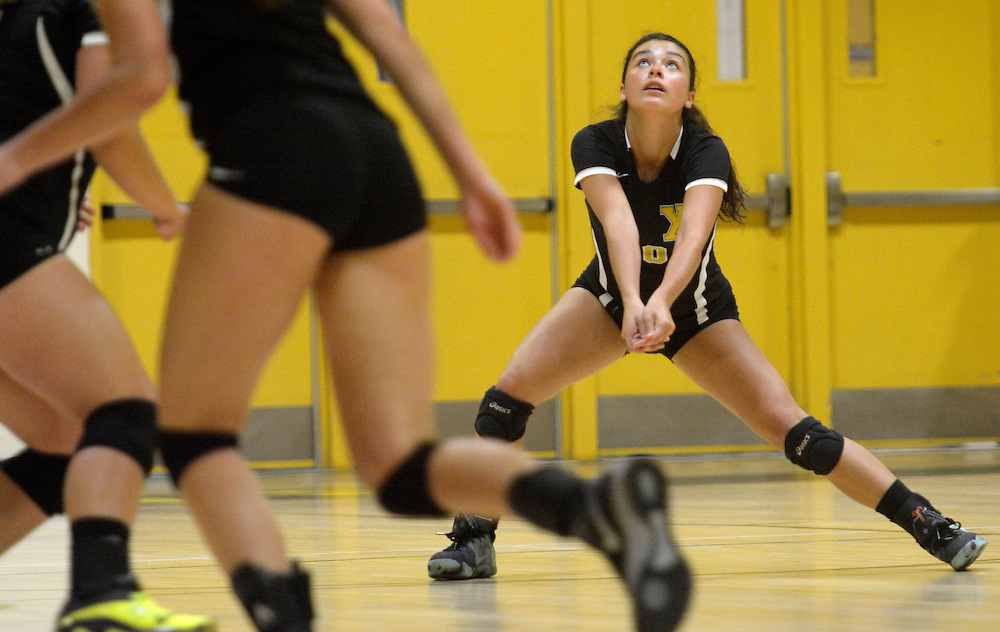 gbs091316q/SPORTS -- St. Pius' Julianna Zamora, 10, gets set for a dig during game against Sandia Prep at Pius on Tuesday, September 13, 2016. (Greg Sorber/Albuquerque Journal)