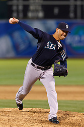 OAKLAND, CA - APRIL 07: Brandon League #43 of the Seattle Mariners pitches against the Oakland Athletics during the ninth inning at O.co Coliseum on April 7, 2012 in Oakland, California. The Seattle Mariners defeated the Oakland Athletics 8-7. (Photo by Jason O. Watson/Getty Images) *** Local Caption *** Brandon League