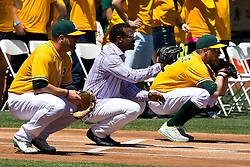 OAKLAND, CA - AUGUST 09:  Stephen Vogt #21 of the Oakland Athletics, former player Rickey Henderson and Sean Doolittle #62 catch ceremonial first pitches before the game against the Houston Astros at O.co Coliseum on August 9, 2015 in Oakland, California. The Oakland Athletics defeated the Houston Astros 5-4. (Photo by Jason O. Watson/Getty Images) *** Local Caption *** Stephen Vogt; Rickey Henderson; Sean Doolittle