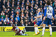Marvelous Nakamba (Aston Villa) on the ground as Neal Maupay (Brighton) looks up at the mid air ball during the Premier League match between Brighton and Hove Albion and Aston Villa at the American Express Community Stadium, Brighton and Hove, England on 18 January 2020.