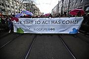 Frankfurt am Main | 18 Mar 2015<br /> <br /> Blockupy-Proteste in Frankfurt am 18.03.2015, hier: Blockupy-Abschlussdemo in der Kurt-Schuhmacher-Strasse, Transparent mit der Aufschrift &quot;Our Time To Act Has Come!&quot;.<br /> <br /> photo &copy; peter-juelich.com
