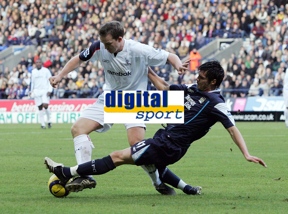 Photo: Paul Thomas.<br />Bolton Wanderers v Manchester City. The Barclays Premiership. 21/01/2006.<br />Bolton's Kevin Davis (L) is tackled by Stephen Jordan.