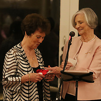 Gum Tree Art Museum Board member Lucy Gaines, right, surprises Nancy Diffee with an endowment fund in her name for the Gum Tree Art Museum