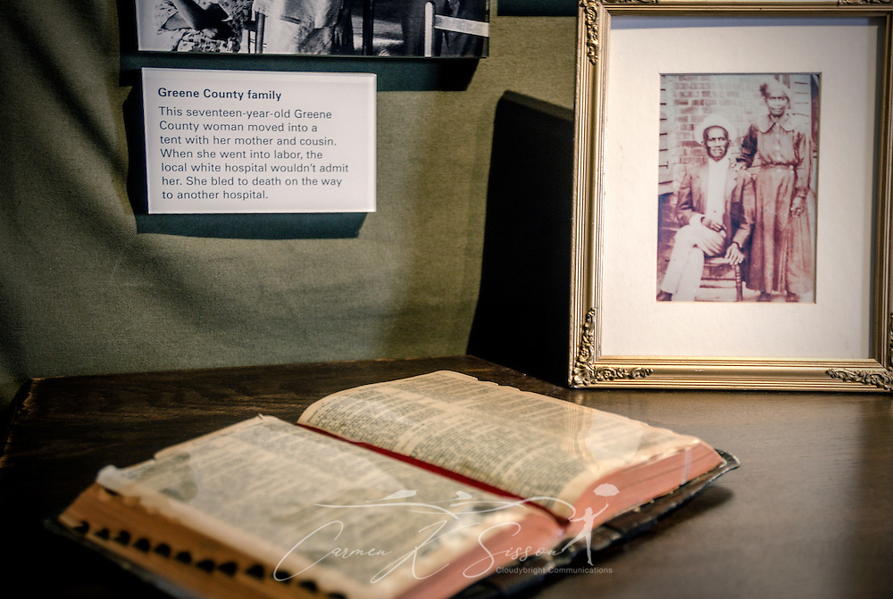 """A Bible is opened to Psalm 23 at Lowndes Interpretive Center, Feb. 3, 2015, in Hayneville, Ala. Many tenant farmers were thrown off their land after registering to vote, leading many to settle in temporary """"Tent Cities."""" This exhibit at the center replicates the bedroom a resident may have had. (Photo by Carmen K. Sisson/Cloudybright)"""