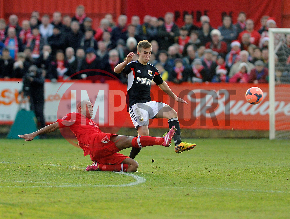 Bristol City's Joe Bryan is tackled by Tamworth's Wayne Thomas - Photo mandatory by-line: Dougie Allward/JMP - Tel: Mobile: 07966 386802 08/12/2013 - SPORT - Football - Tamworth - The Lamb Ground - Tamworth v Bristol City - FA Cup - Second Round