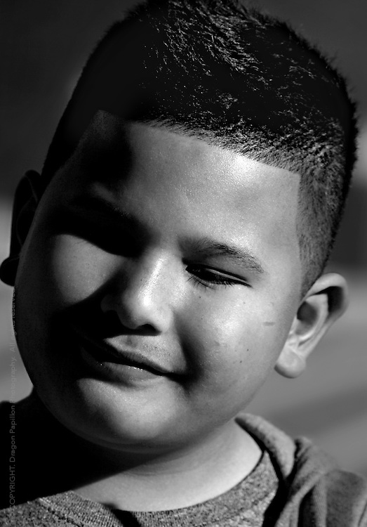 black and white male youth portrait with tender smile and eyes almost closed